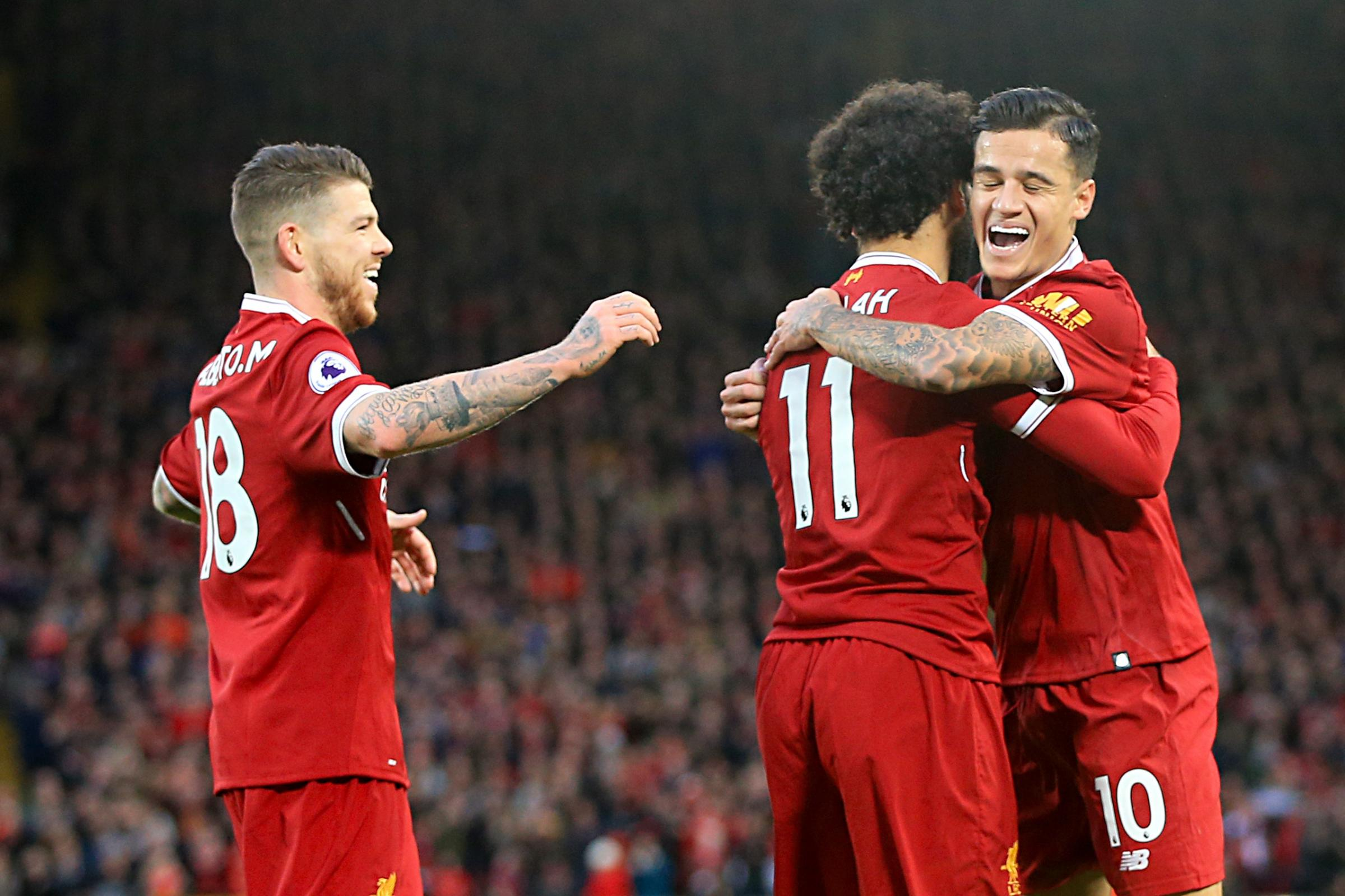 Mohamed Salah celebrates scoring with Philippe Coutinho, right (Peter Byrne/PA Wire)