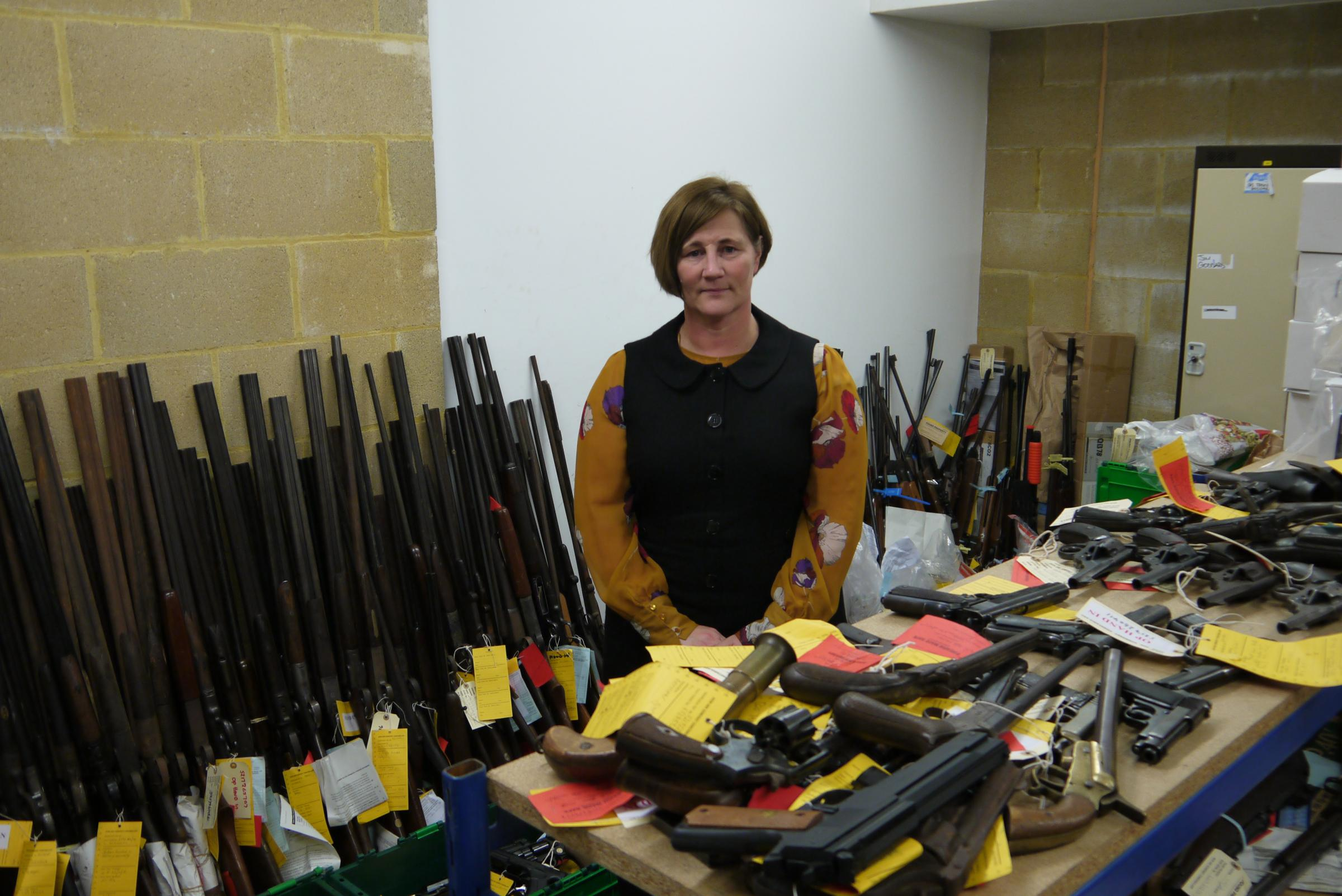 Superintendent Carolyn Belafonte with the weapons surrendered to Avon and Somerset Police