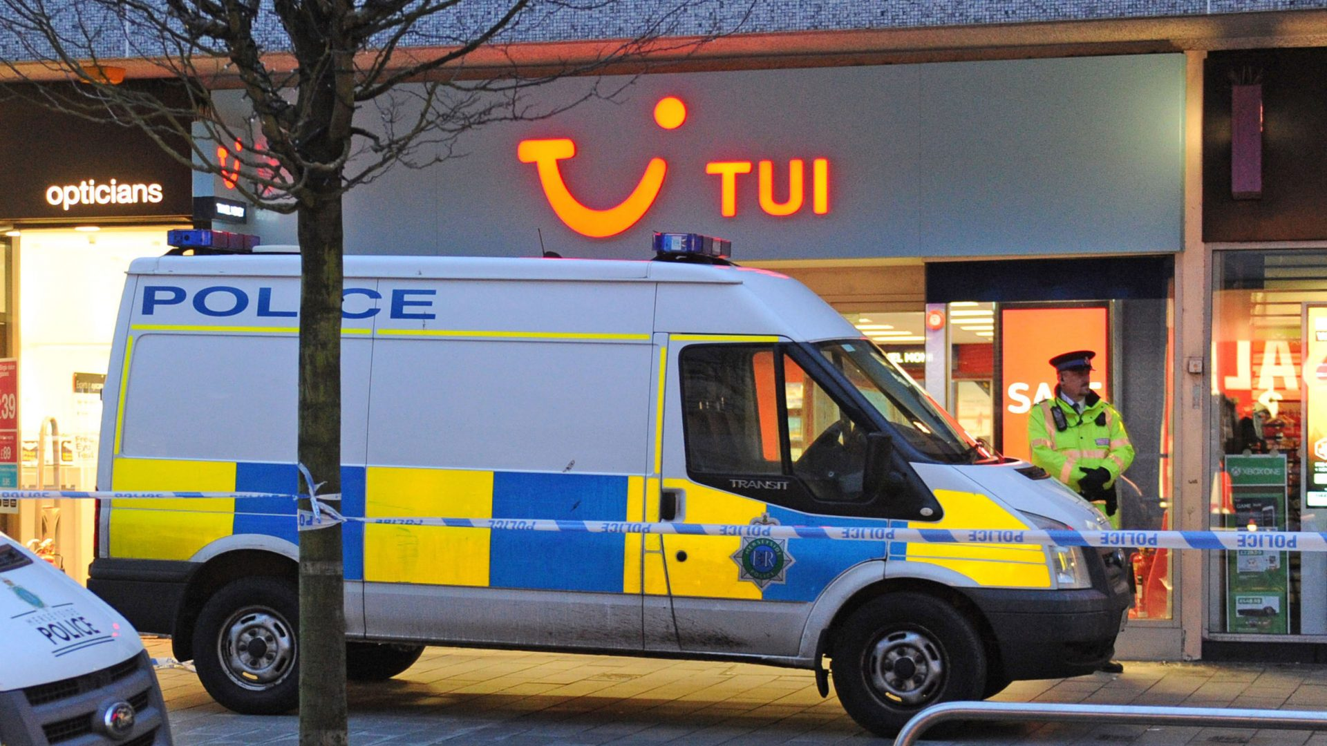 Police outside a travel agents in Southport (PA)