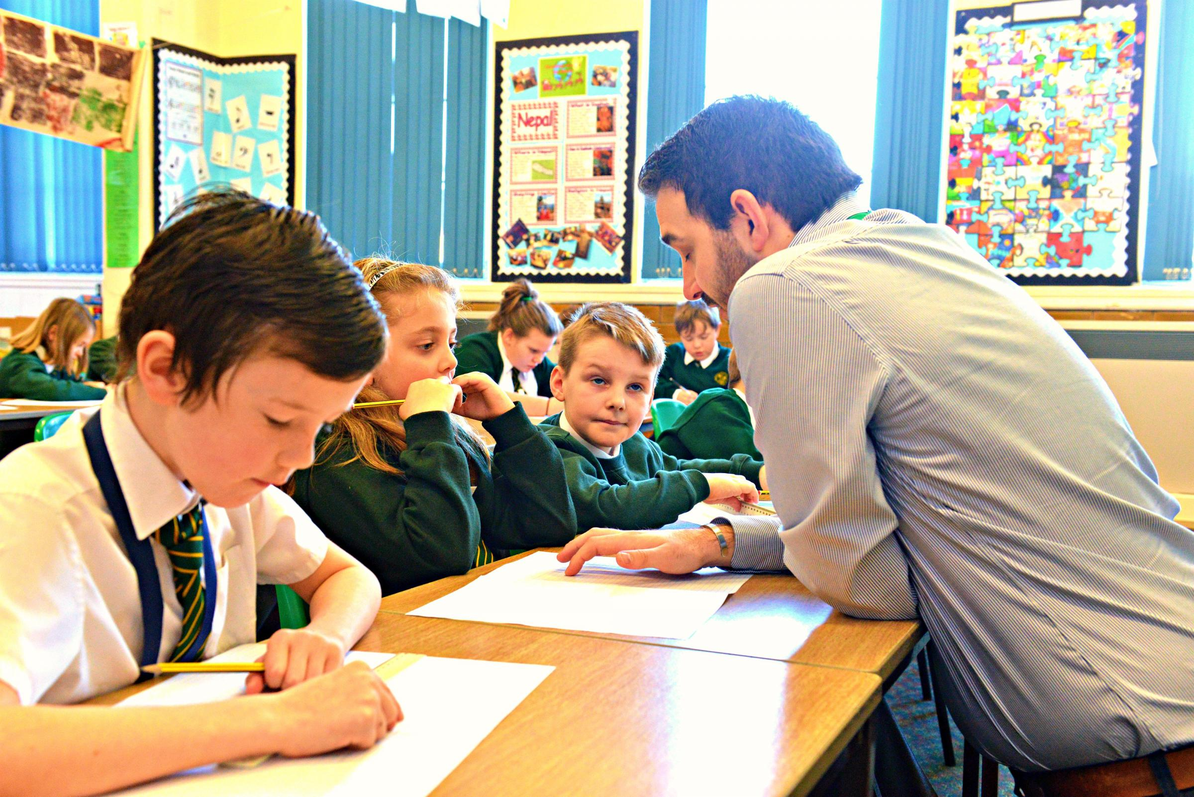 Berkeley Primary School teacher Alex Hart working with the pupils in the school's high ability maths group