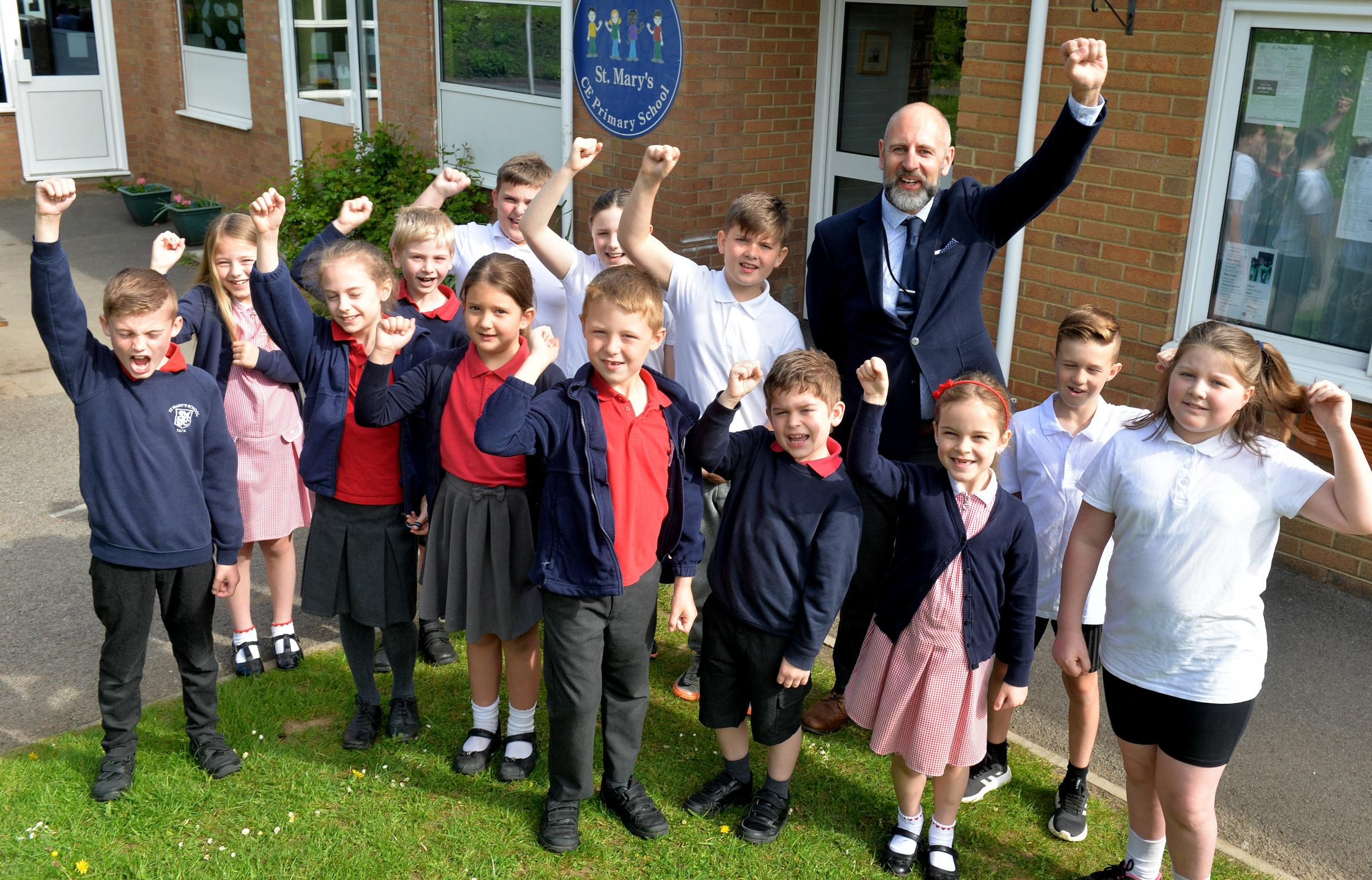 Head teacher at St Mary's Primary School in Yate, John Bird with members of the school's council celebrating their recent Ofsted report