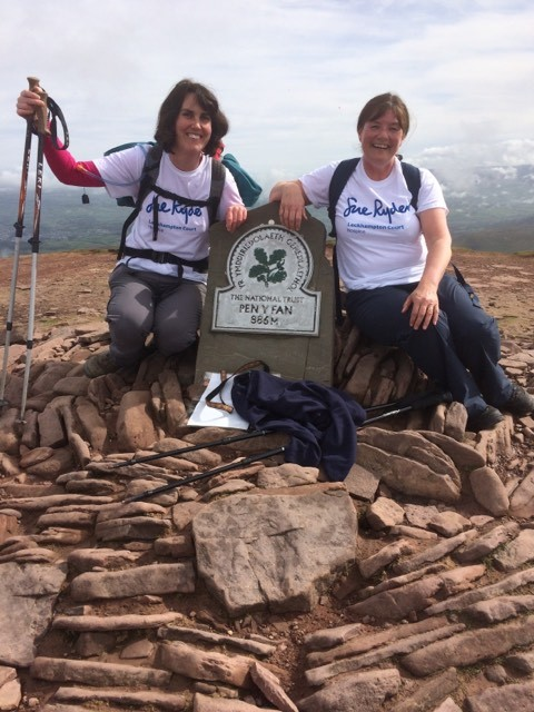 Becky Harris and Sarah Sharp atop Pen Y Fan during their Three Peaks Challenge