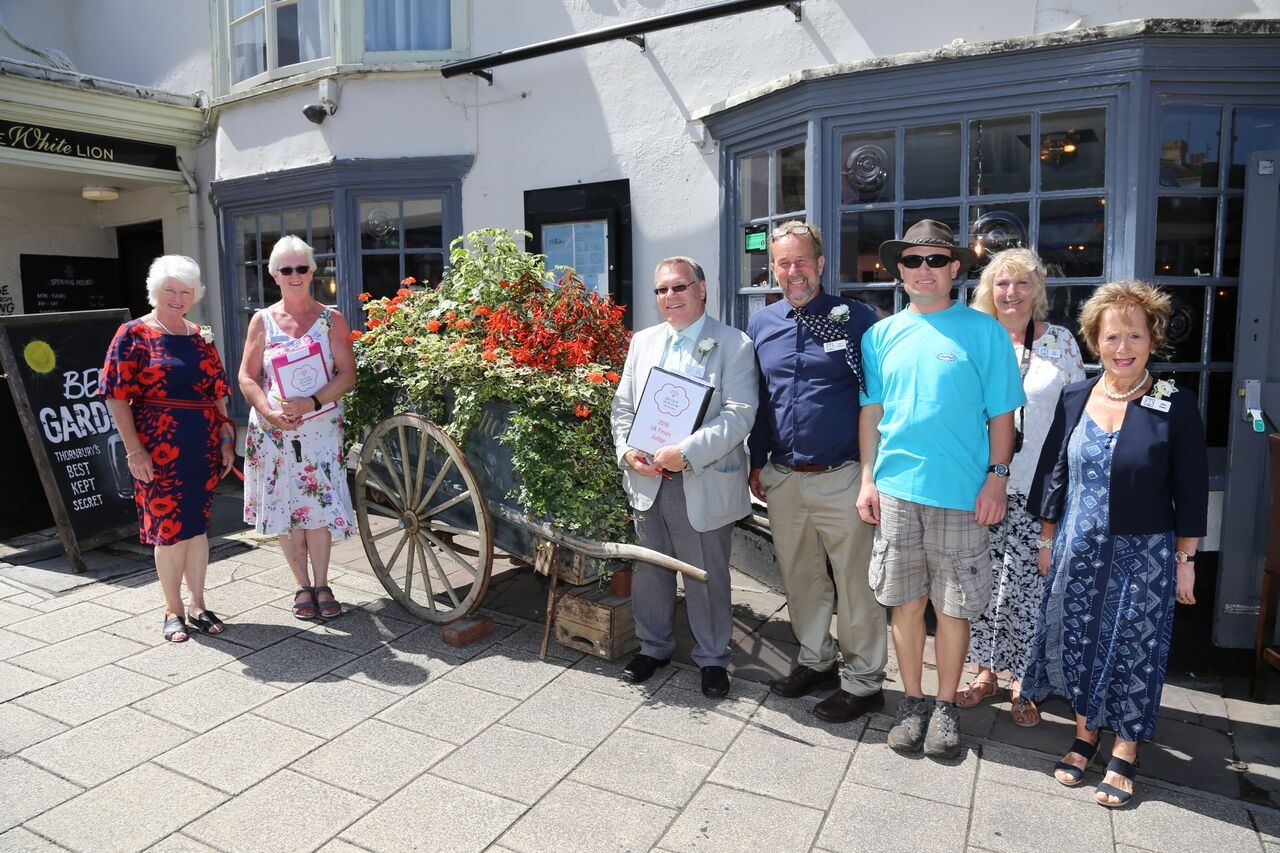 Thornbury In Bloom representatives and RHS judges during last year's event. Photo: John Brimmacombe