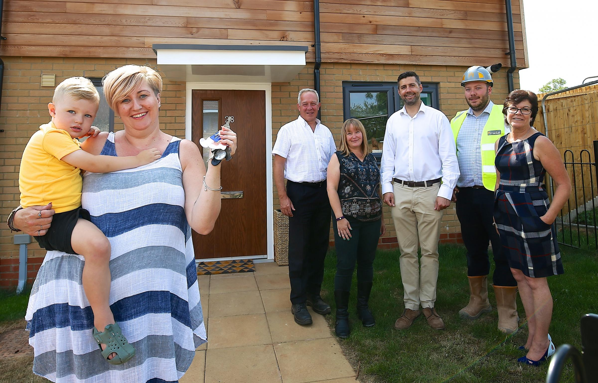 Ms Samantha Burge new resident at 28 Hoopers Walk , long well Green with son Aibie and members of SGC