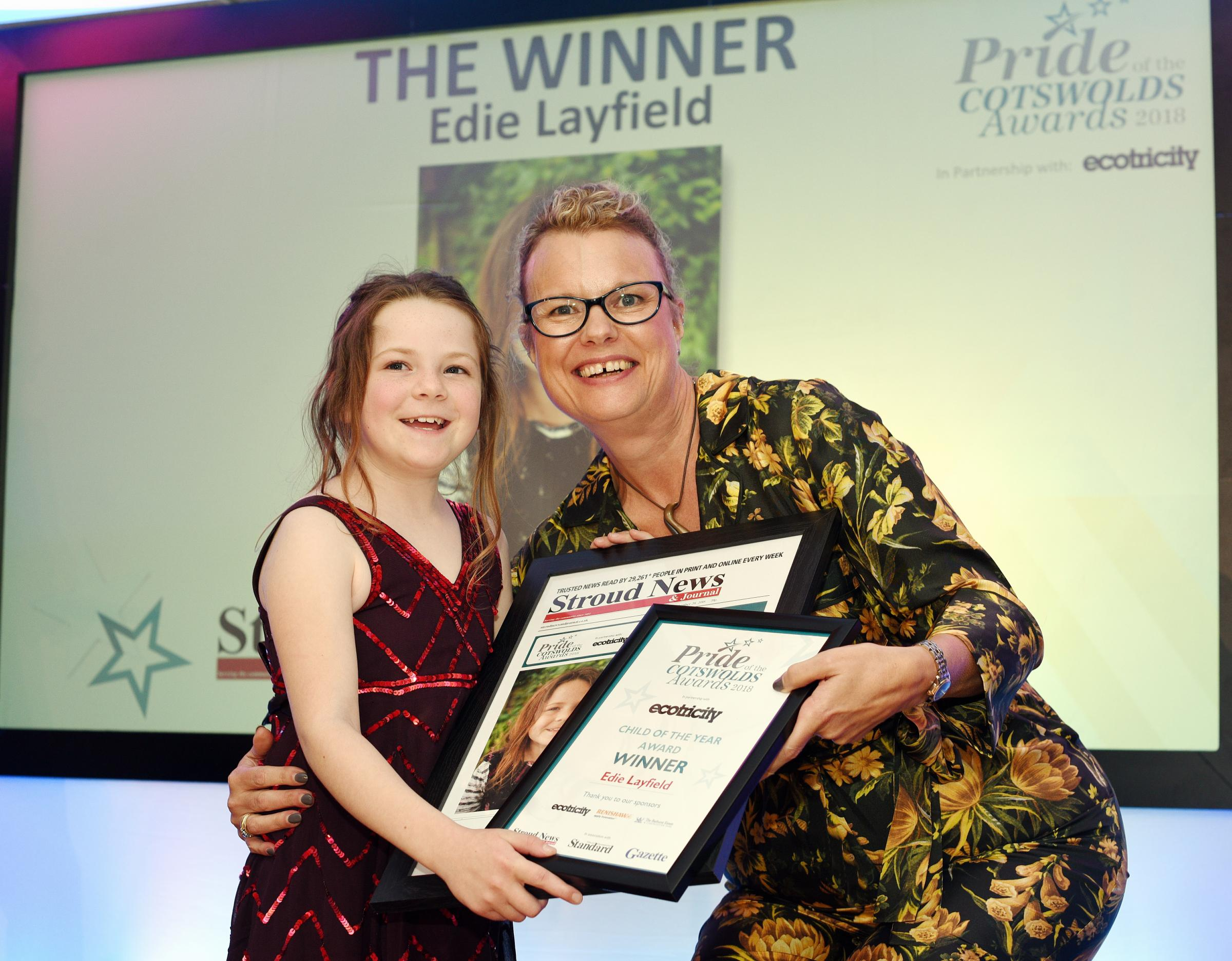 Child of the Year, Edie Layfield, eight receives her award from Newquest Events Director Sue Griffiths. Pride of the Cotswolds Awards,  at  Forest Green Rovers.