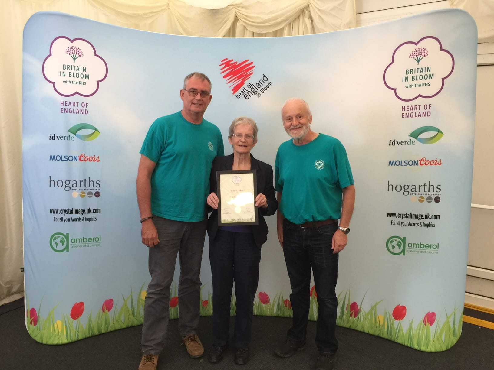 Committee members Alex Wilkinson, Ruth Yorke and Trevor Mason with the town's award