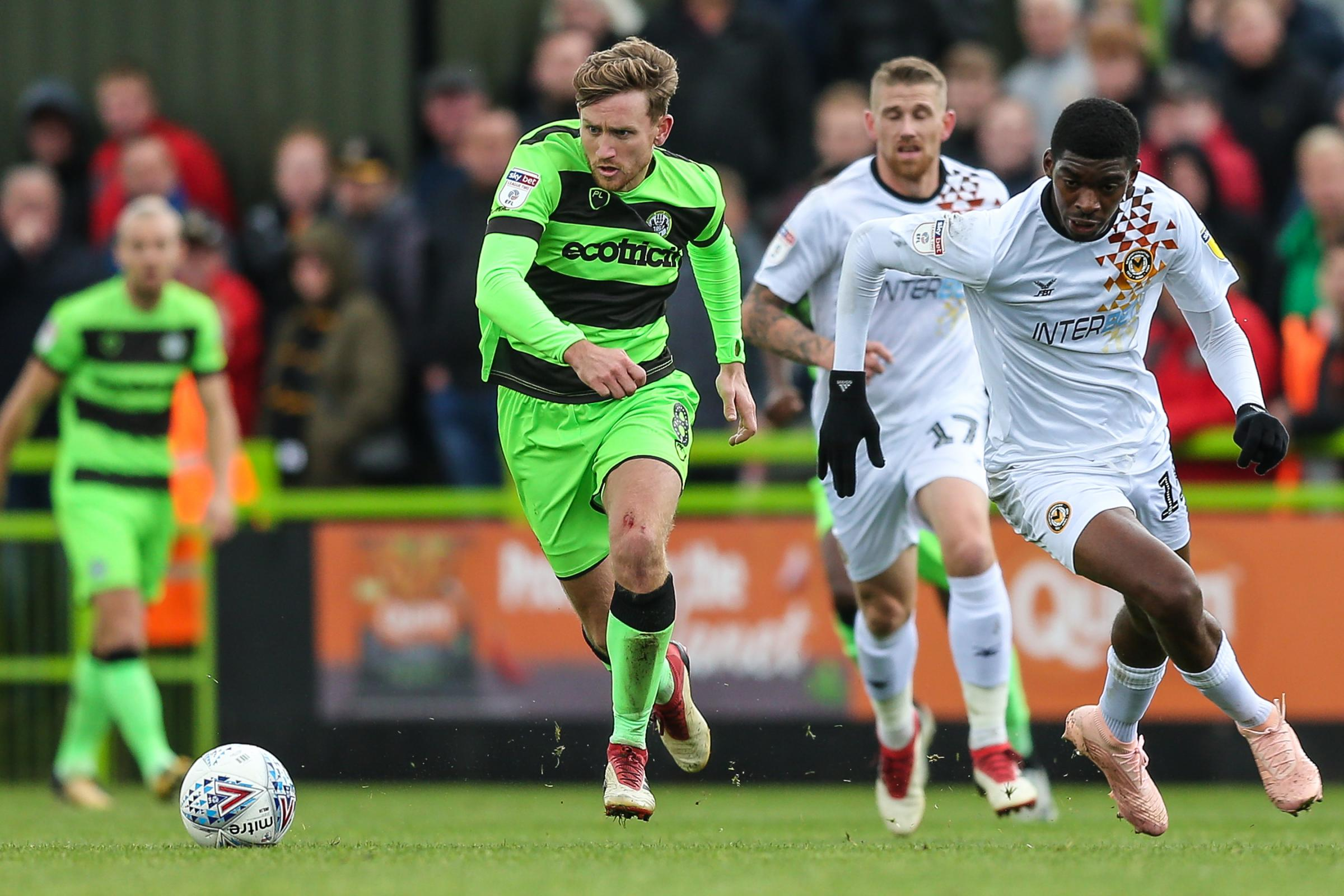 Forest Green Rovers Dayle Grubb(8) runs past Newport County's Tyreeq Bakinson(15) during the EFL Sky Bet League 2 match between Forest Green Rovers and Newport County at the New Lawn, Forest Green, United Kingdom on 6 October 2018.