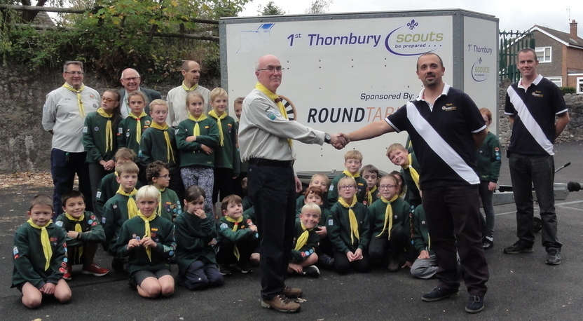 Rob Mills, group scout leader and Rocco Cerullo, chairman of Thornbury Round Table, with members of 1st Thornbury Scout Group
