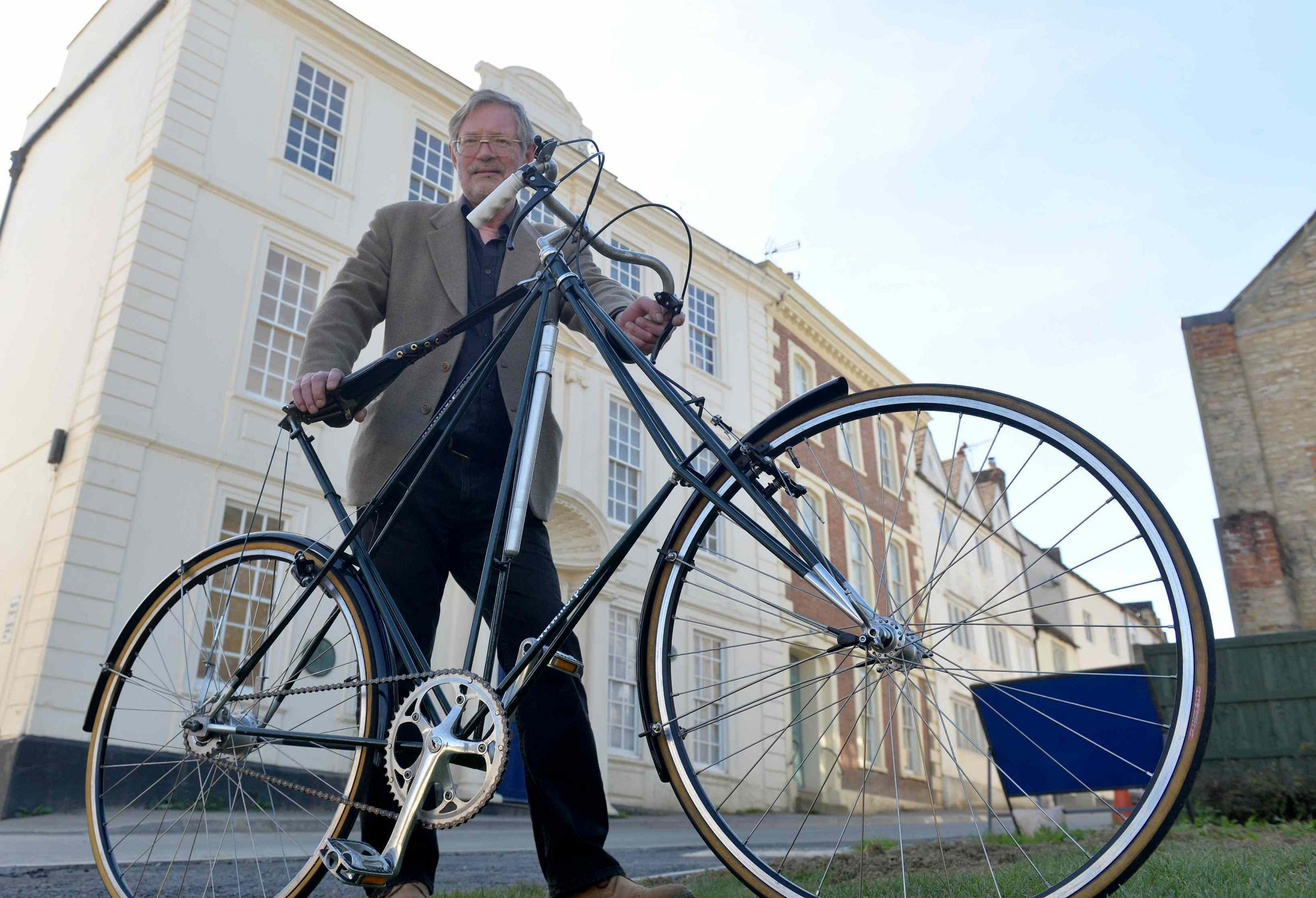 Ed Green with his hand built Pedersen cycle outside Raglan House in Dursley