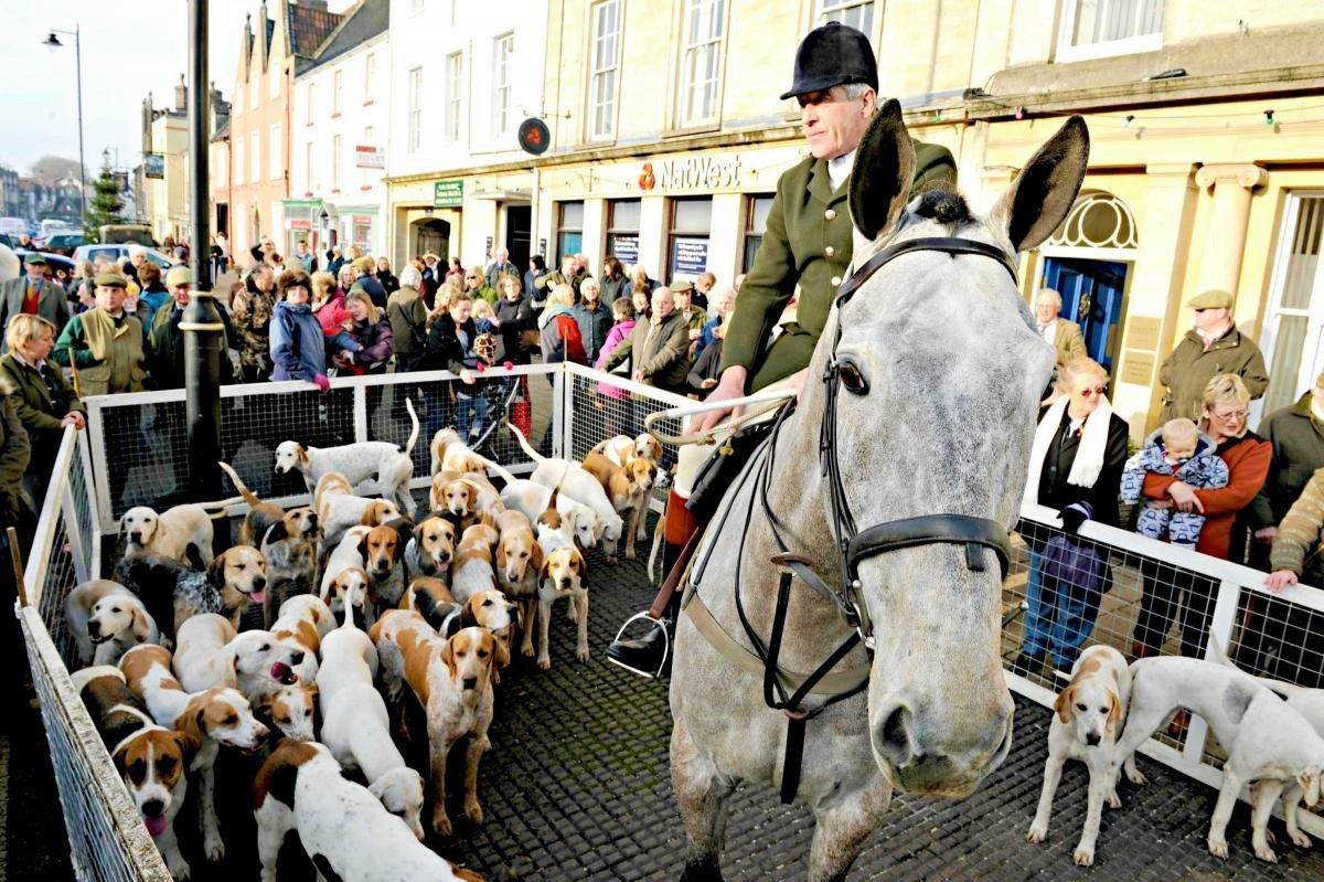 Huntsman Tony Holsworth and the Beaufort Hunt hounds at a meet in Chipping Sodbury