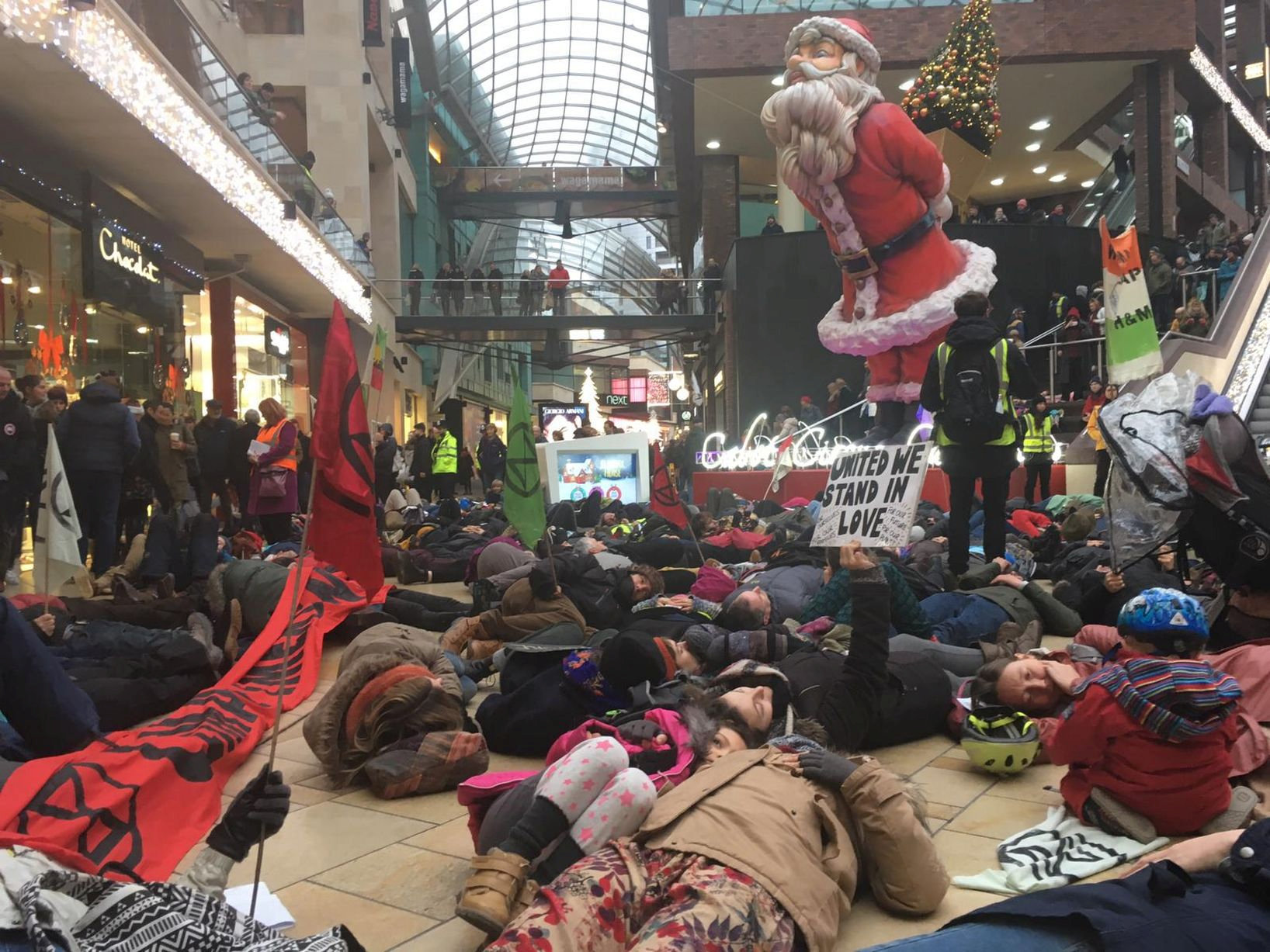 Bristol protest inside Cabot Circus. See SWNS story SWCAprotest; Hundreds of protesters have been photographed performing a