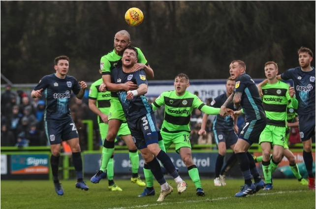 Farrend Rawson beats Bury's Chris Stokes to the ball during the match between Forest Green Rovers and Bury at the New Lawn, Forest Green, United Kingdom on 19 January 2019. Phot: Pro Sports Images Ltd
