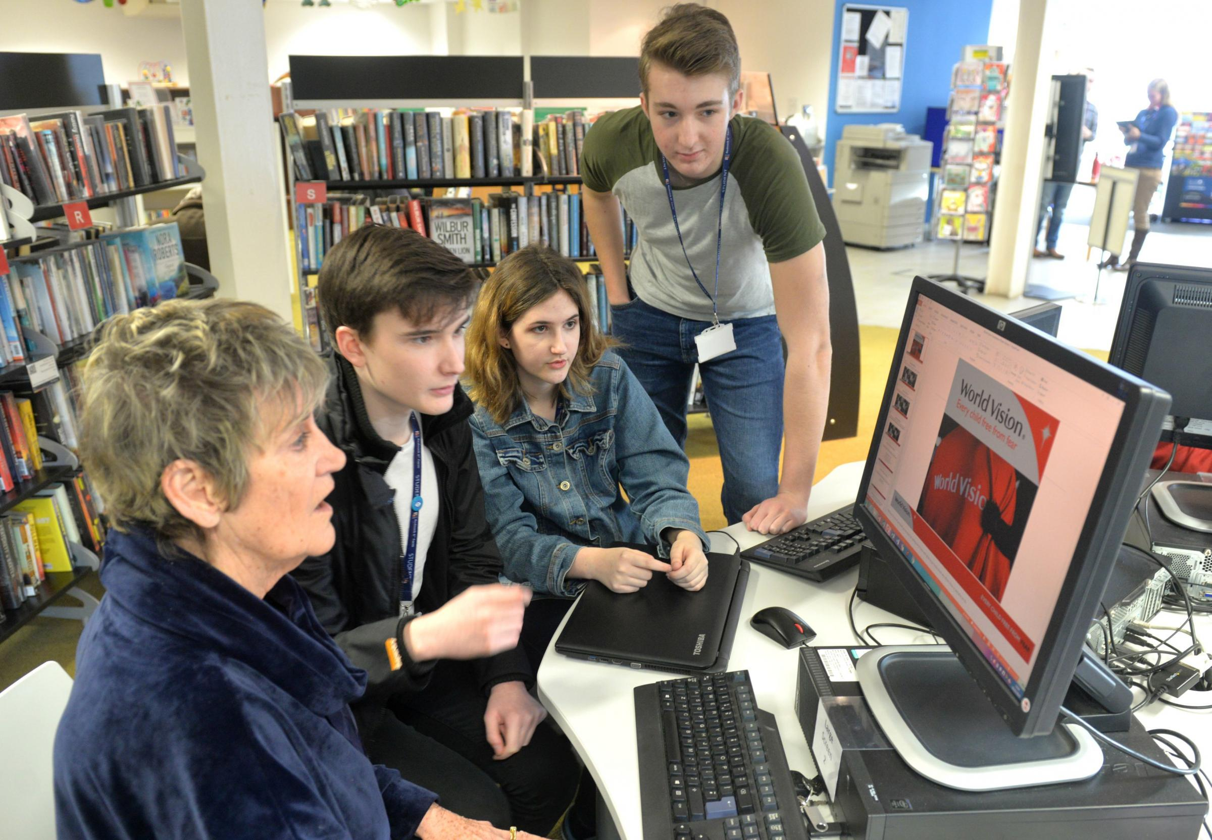 Dr Eileen Shaw with Rednock 6th form pupilsAdam Bennett, Josie Morris and Alex Robinson in Dursley Library