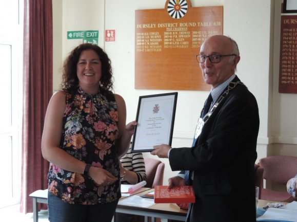 "One of last year's recipients, Kate Reynolds collecting her ""Unsung Hero"" award for outstanding service to the community of Dursley, from the Mayor of Dursley"