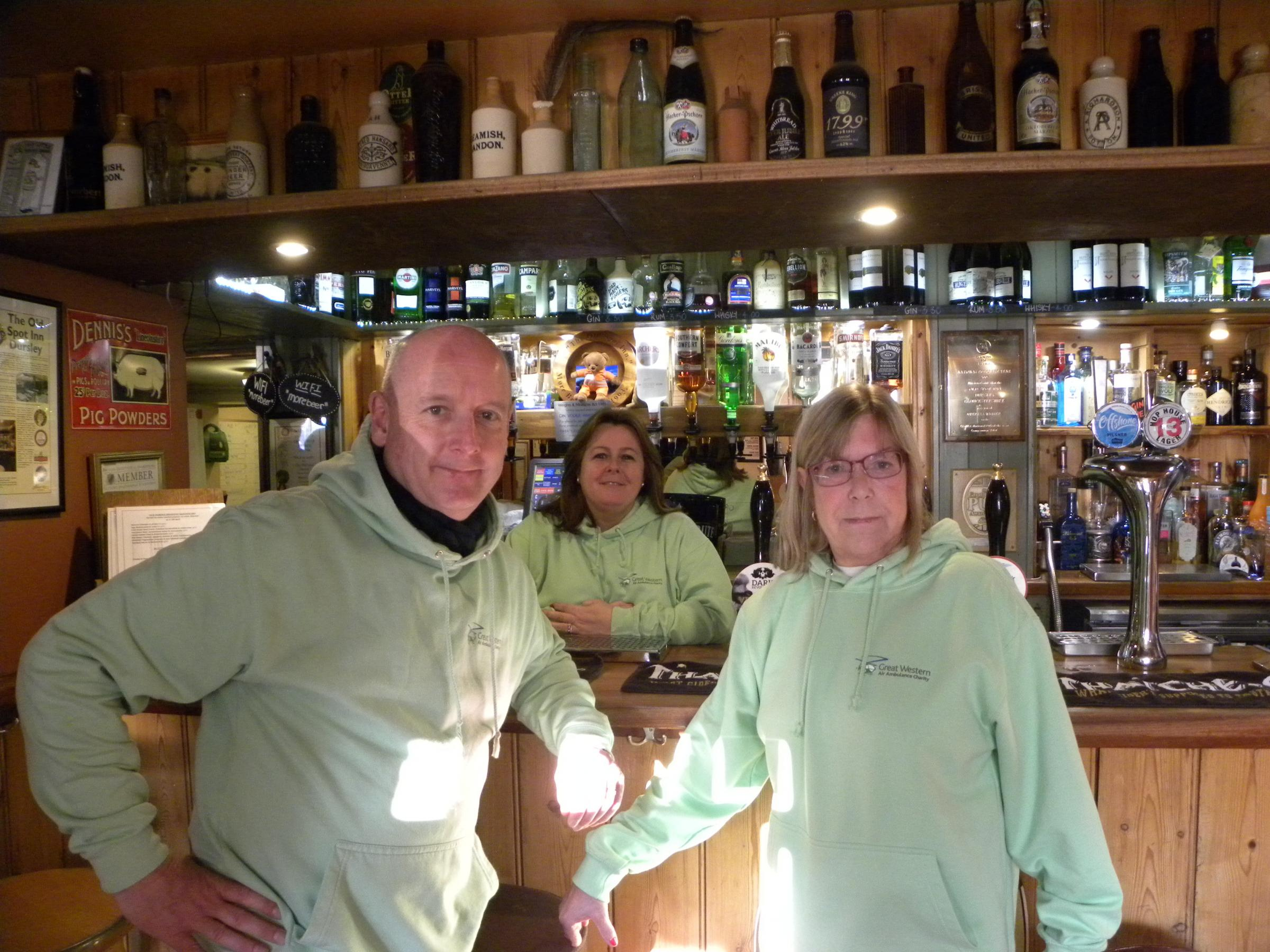 Fundraisers at the Old Spot. Left to right: Andy Markham, Jo Lewis, who manages the Old Spot, and Judith Rubin, who raised £600 for GWAAC by knitting a scarf and running a 'guess the length of the scarf' competition.