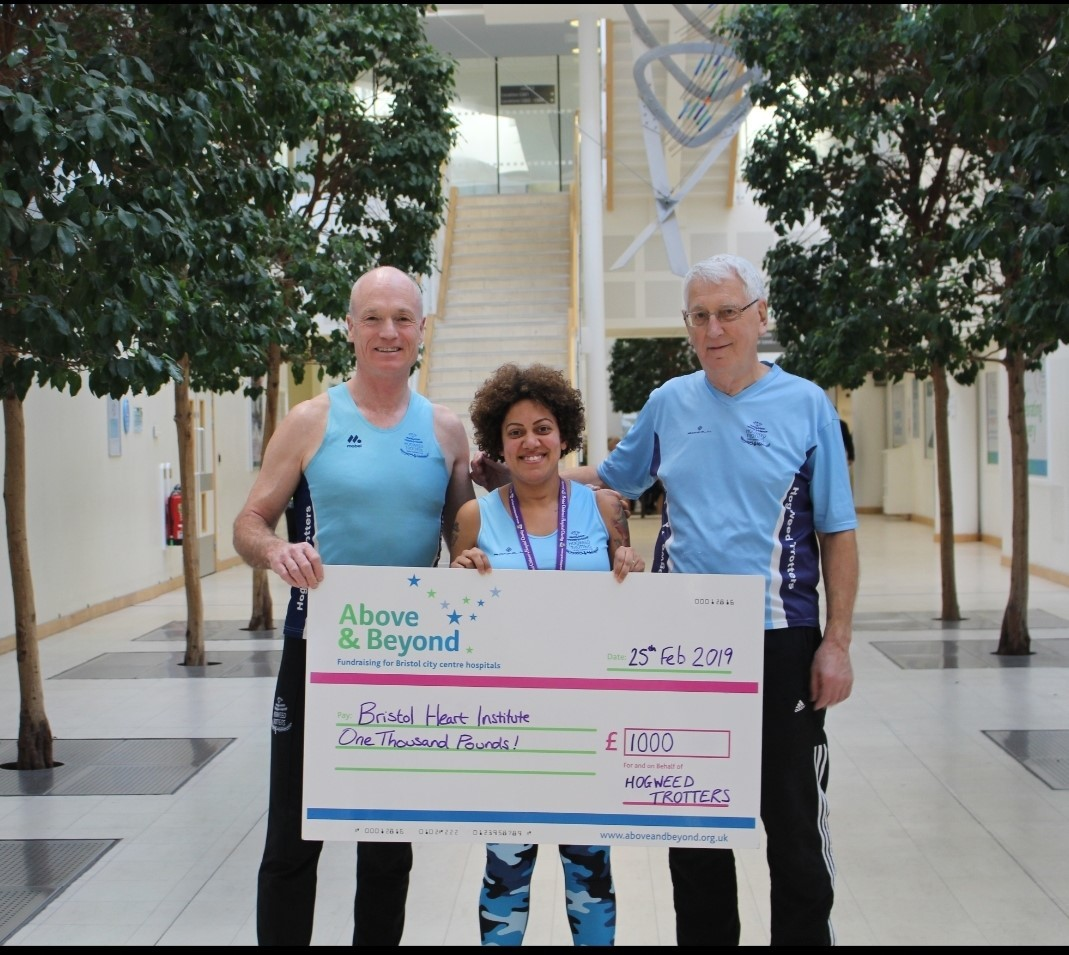Members of the Hogweed Trotters with their donation to the University Hospitals Bristol Foundation