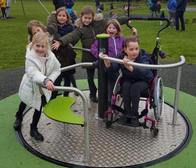 Children enjoy the new play equipment
