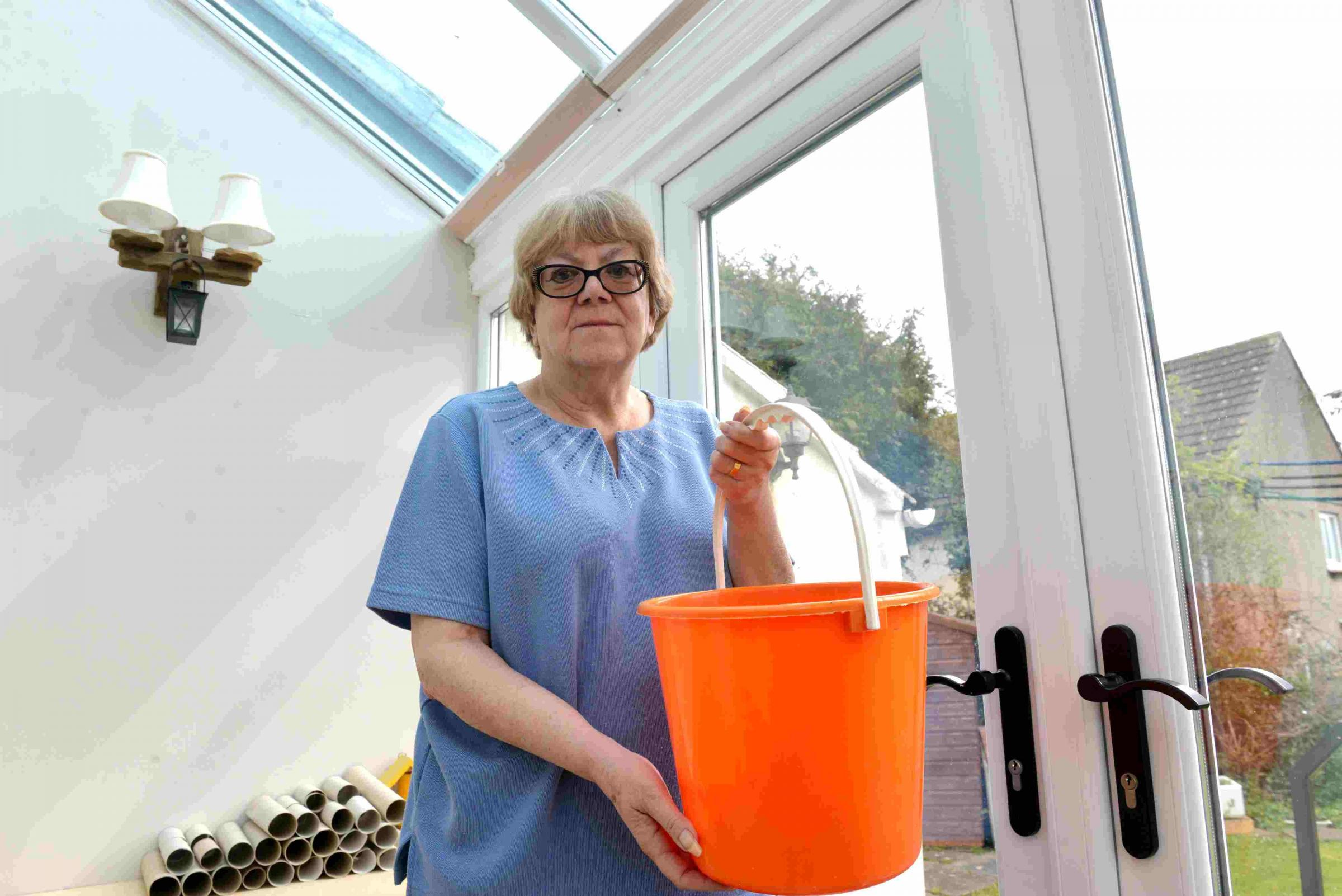 Jan Davies at her home in Chipping Sodbury in her leaking conservatory.