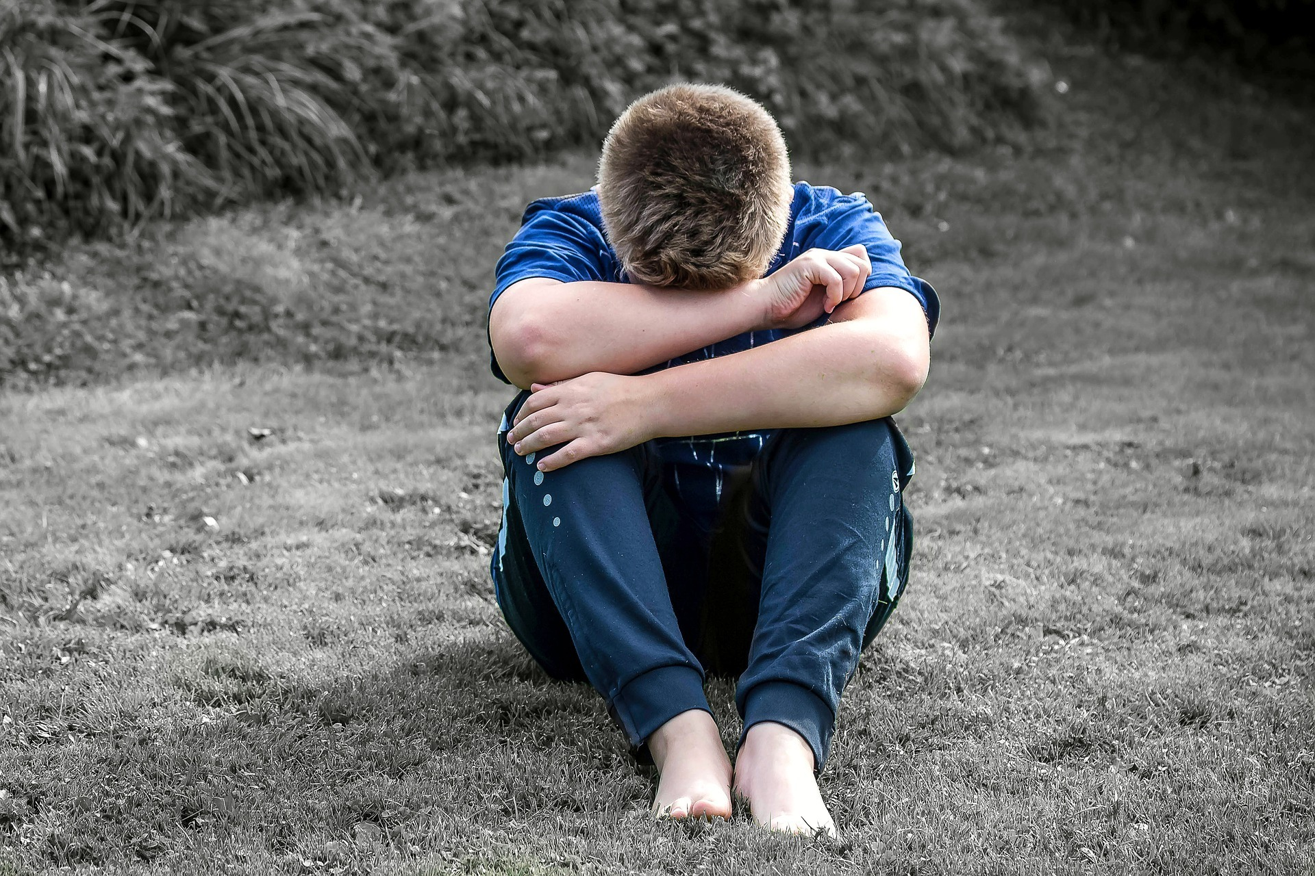 Stock photo of abused boy (free to use by all partners)