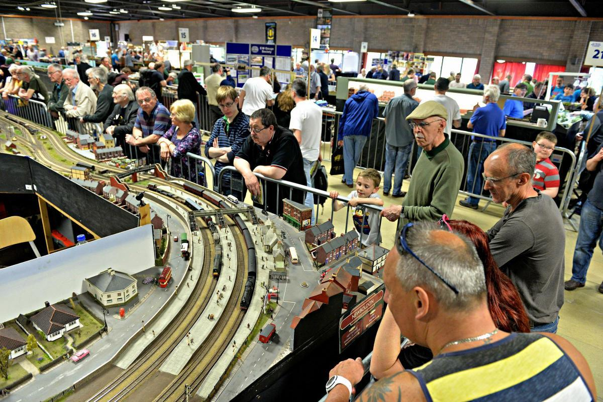 Visitors take a look at one of the larger model railway layouts at the Bristol Model Railway Exhibition in 2018