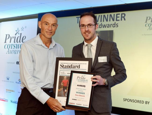 Steve Edwards receives his Sporting Hero award from the Newsquest Gloucestershire's head of media sales Carl Badham