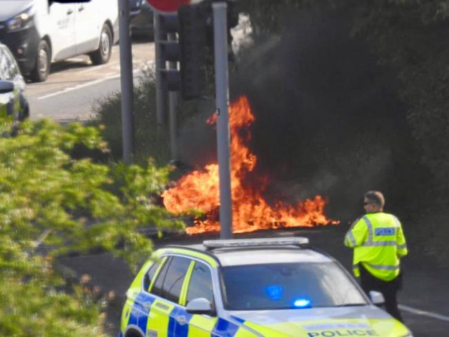 The motorbike on fire, picture by Pete Knight
