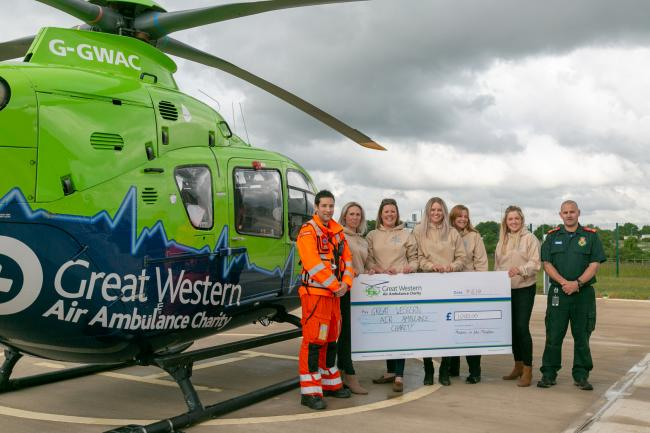 Mellow in the Meadow organisers with representatives from Great Western Air Ambulance Charity