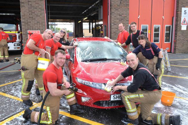 Yate firefighters during their charity car wash raising money for Cancer Research UK and the Firefighters Charity